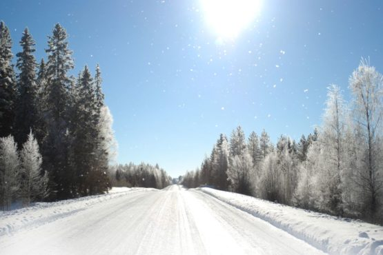 Photo shows the winter sightseeing road from Villa Cone Beach to Kuhmo town center. Wind flies snowflakes in a very bright sunshine.