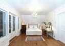 Photo shows Villa Cone Beach Master bedroom with a double bed and dark night behind the balcony door and windows.
