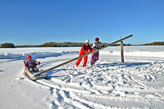 Winter fun with a merry-go-round sledge in winter wonderland.